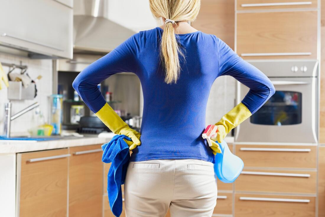 house cleaner in front of kitchen