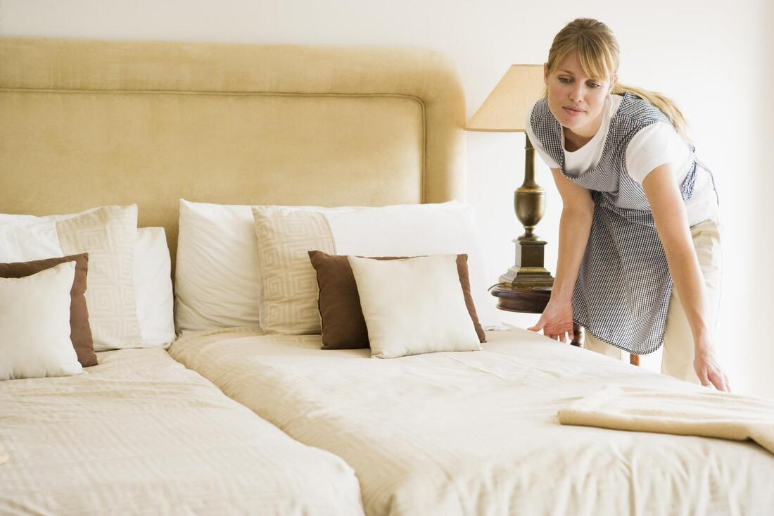 house cleaner doing mattress cleaning